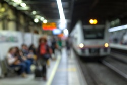 (Barcelona, Catalonia - November 11, 2016) - Defocused silhouettes of passengers on an underground platform, waiting for the arrival of the train.