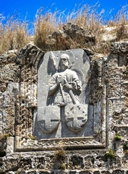 Bas-relief, heraldry, image of knight, crusaders, order of St. John of Jerusalem