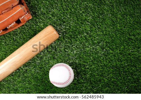 baseball, glove, ball and bat on field
