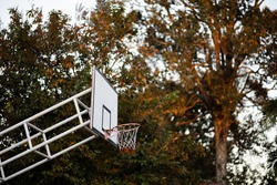 Basketball hoop and basketball hoop On a warm sunny day it is suitable for physical exercise.