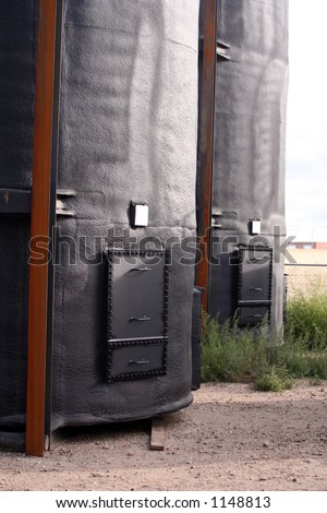 400bbl. oil storage tanks. Exterior is foam insulated and sprayed black. Interior is coated with a corrosion resistant lining. Tanks are sitting on very corroded bare metal skids.