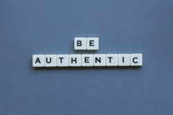 ' Be Authentic ' word made of square letter word on grey background.
