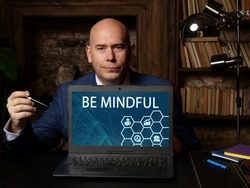 BE MINDFUL inscription on the computer. Conceptual photo showing paying close attention to or being especially conscious of something
