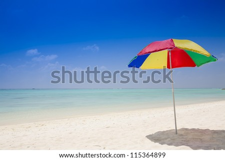 beach with a sunshade under a deep blue sky
