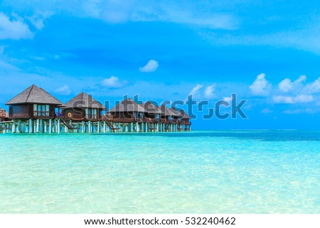 beach with water bungalows at Maldives #532240462