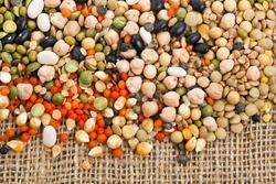 beans, legumes, peas, lentils on the sackcloth background