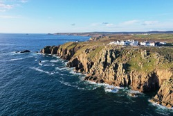 `Beautiful aerial view of rocky and rugged coastline, cliffs and ocean at lands end in Cornwall