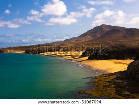 Beautiful beach and sea in Lanzarote island Spain ,whith mountains as background