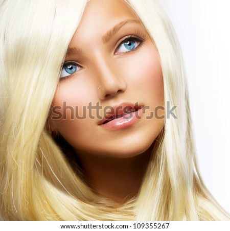 Beautiful Blond Girl isolated on a White Background.Blonde Hair.