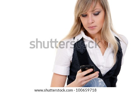 Beautiful  businesswoman looking at smart phone while text messaging
