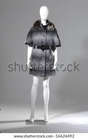 Beautiful female black and white fur coat on a light background