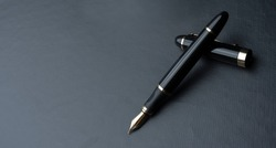Beautiful fountain pen. under exposed photo on a black background.