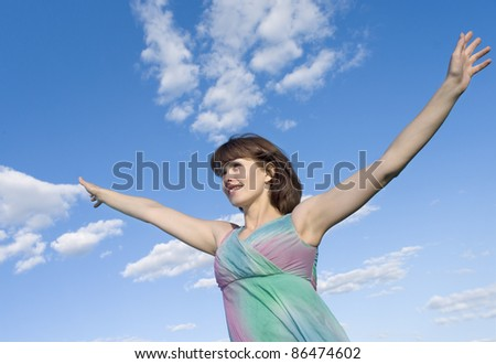 beautiful girl over sky background