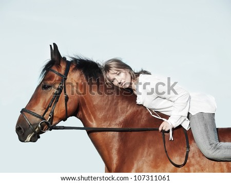 beautiful  girl  riding on horse  sunny evening