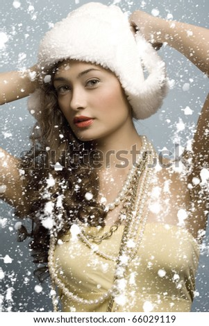 beautiful girl with hat in winter with snow