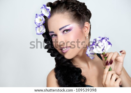 beautiful girl with stylish makeup and flower