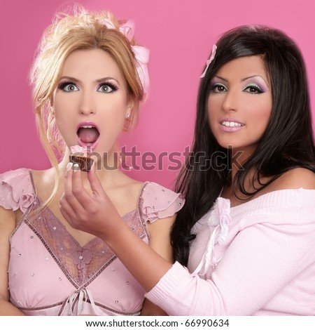 beautiful girls eating diet sweet on pink background