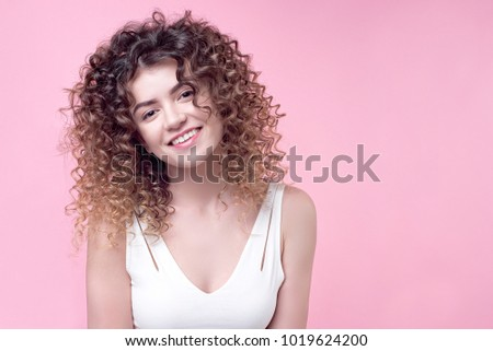 Beautiful people.Beautiful young girl with a stylish curly hairstyle..Amazing hairstyle female brunette curly shine hair.