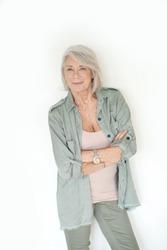 Beautiful senior woman smiling on isolated white background