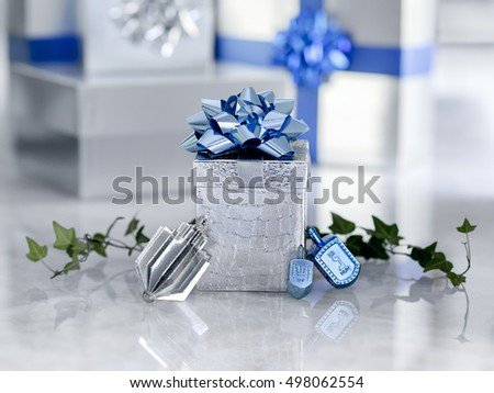Beautiful silver and blue Chanukah gifts and dreidels for the Jewish holiday Hanukkah sit on  quartzite with copy space