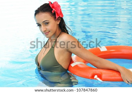 Beautiful smiling brunette  woman in a swimming pool