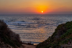 Beautiful sunset on the mediterranean sea. Steep descent