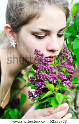 stock-photo--beautiful-teen-girl-smelling-lilac-blossoms-close-up-52553788.jpg