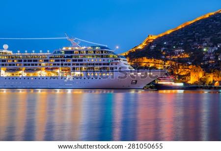 Beautiful white giant luxury cruise ship on stay at Alanya harbor