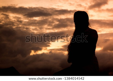 beautiful woman in a sunset #1384014542