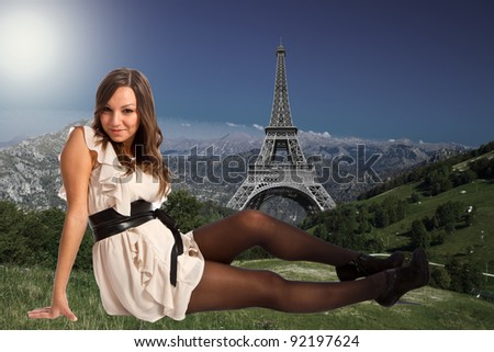 Beautiful woman on a green meadow with landmarks