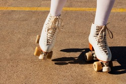 Beautiful woman on roller skates on a court located in a sports park