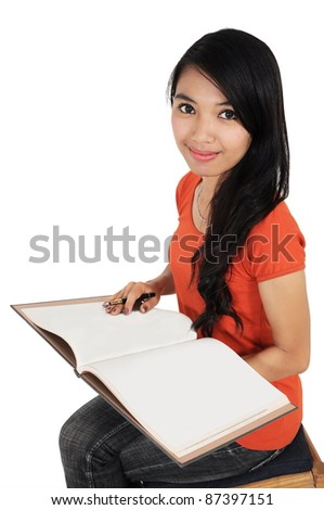 beautiful woman smiling and carrying a book isolated on white background