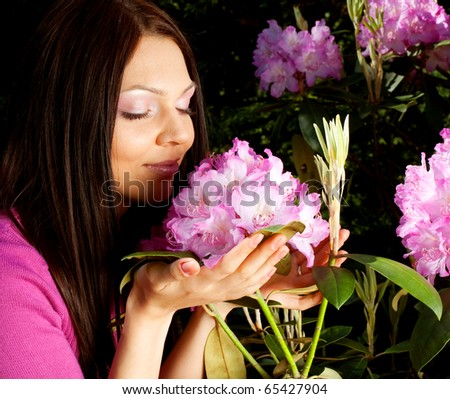 Beautiful woman smiling outdoors with some flowers