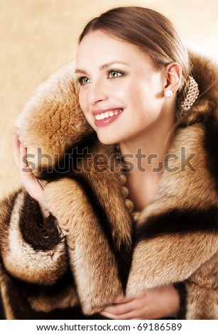 Beautiful Woman Wearing A Mink Fur Coat