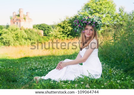 Beautiful woman with a floral wreath
