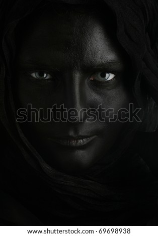 beautiful woman with black face over black background