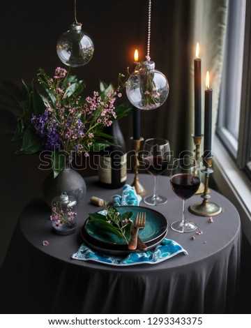 Beautifulspring table fulls of fruit and red wine on rustic dark background. Serve table. Romantic dinner #1293343375
