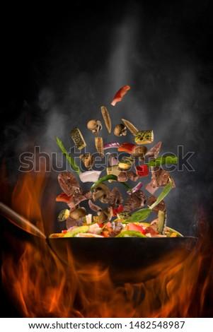 beef tenderloin in the air with wok Zdjęcia stock ©