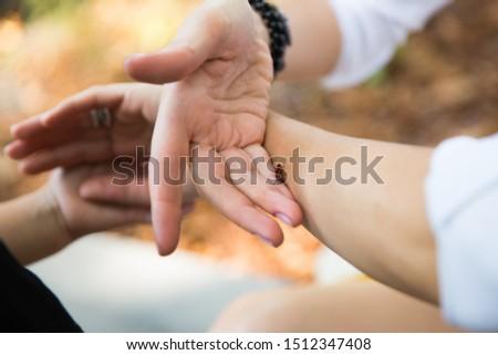 beetle soldier sits on gentle female hands #1512347408
