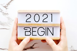 2021 begin, new year positive quotation on wood box background, new year greeting card