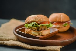 2 Big Burger, Chicken and Beef Burger are served with lettuce, tomatoes, bread, and sauce make a perfect combination of beef burger. Juicy taste and awesome platting very good looking for this food.