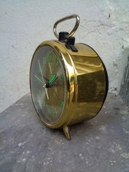Big old vintage  alarm clock on floor
