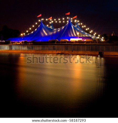 """""""Big Top"""" circus style blue tent and row of lights on the bank of Corrib river in Galway, Ireland"""