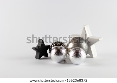 Big white star and little black star with Christmas tree balls. Stok fotoğraf ©