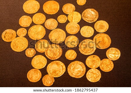 Bisham gold hoard buried around 1564. Mostly half sovereigns of Henry viii. There is also one spanish coin and a venetian ducat. Photo stock ©