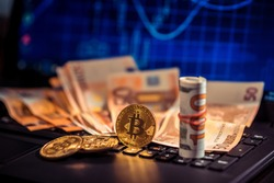 Bitcoins and New Virtual money concept. Growth bitcoins. Euro bills laying on a laptop with bitcoin charts on a blurred background