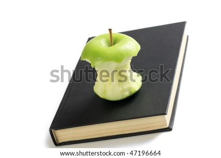 bitten apple on book - stock photo