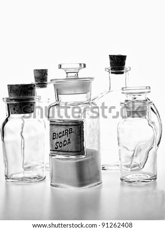 Black and white photo of old time pharmacy bottle of Bicarb. Soda.