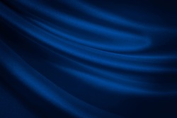 Black blue abstract background. Dark blue silk satin texture background. Shiny fabric with wavy soft pleats. Dark blue elegant background with copy space for your design. Liquid wave effect.