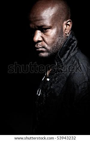 "Black ""gangster men"" looking serious high contrast low key."